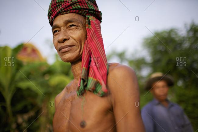 August 6, 2013: Man Wearing A Krama; Battambang, Cambodia