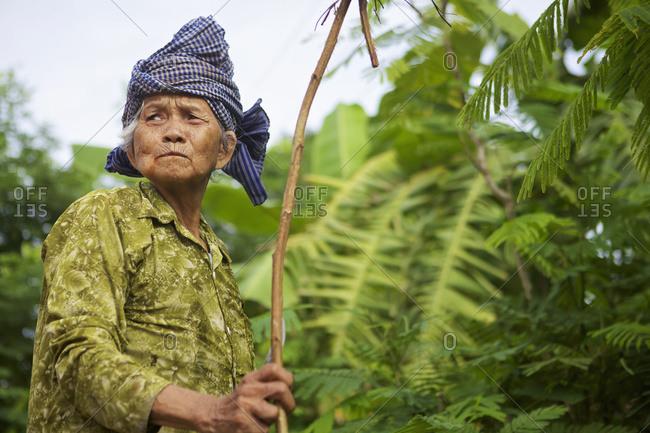 August 9, 2013: Elderly Woman With A Stick; Battambang, Cambodia