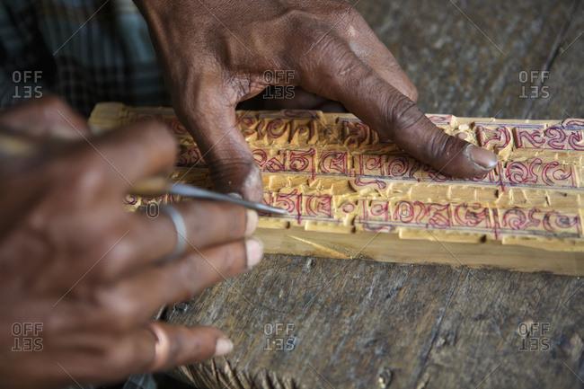 March 10, 2009: Man Making Wood Carving; Kolkata, West Bengal, India