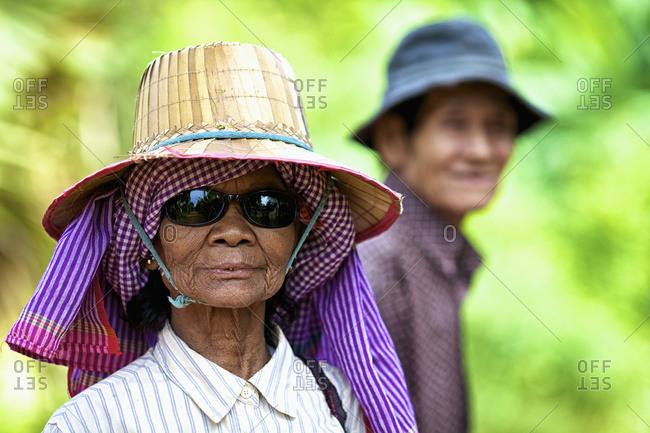 August 8, 2013: Elderly Woman With Her Husband; Battambang, Cambodia