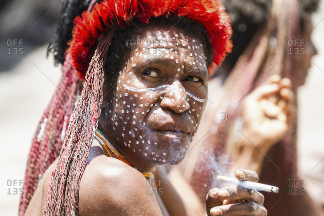 October 4, 2013: Dani Woman Smoking A Cigarette, Obia Village, Baliem Valley, Central Highlands Of Western New Guinea, Papua, Indonesia