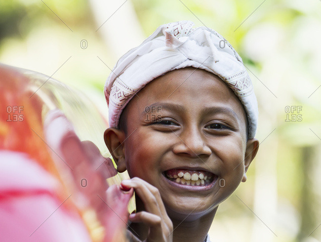 September 18, 2014: Boy At A Ngaben Or Cremation Ceremony, Klungkung, Bali, Indonesia