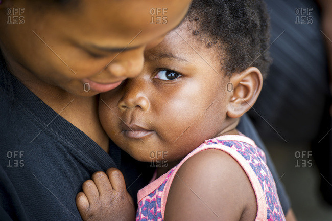 February 2, 2015: African Child In Arms Of Her Mother; Hammanskraal, Gautang, South Africa