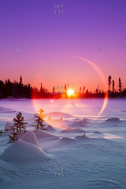 January 25, 2017: Sun Flare Glowing Over A Winter Landscape; Trapper Creek, Alaska, United States Of America