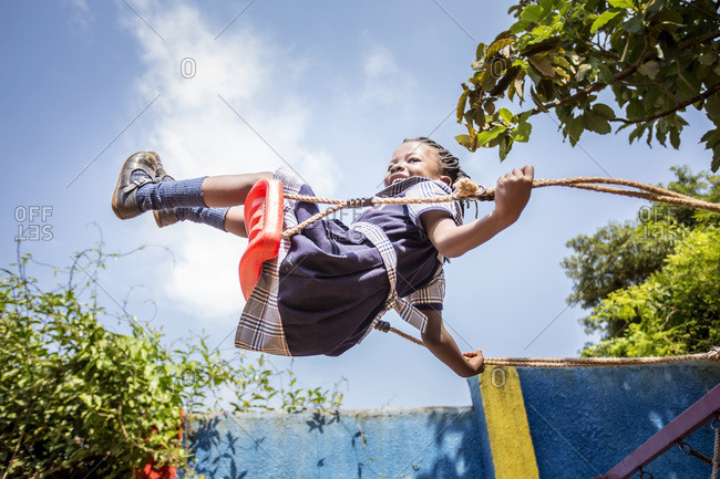 July 7, 2014: A Young Girl Swinging On A Swing In Mid-Air; Kampala, Uganda