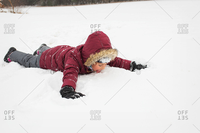 Girl plays in the snow