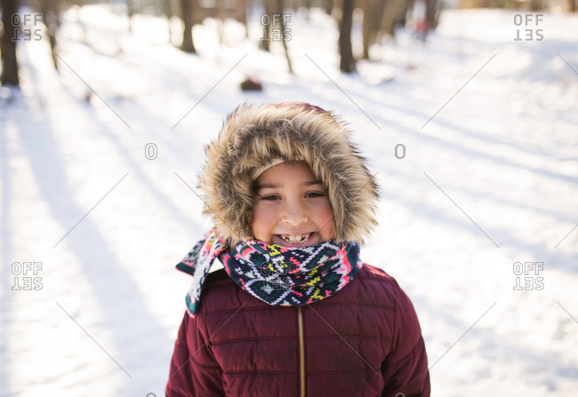 Smiling girl in a colorful winter scarf