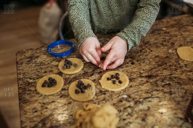 Girl making chocolate hamantaschen