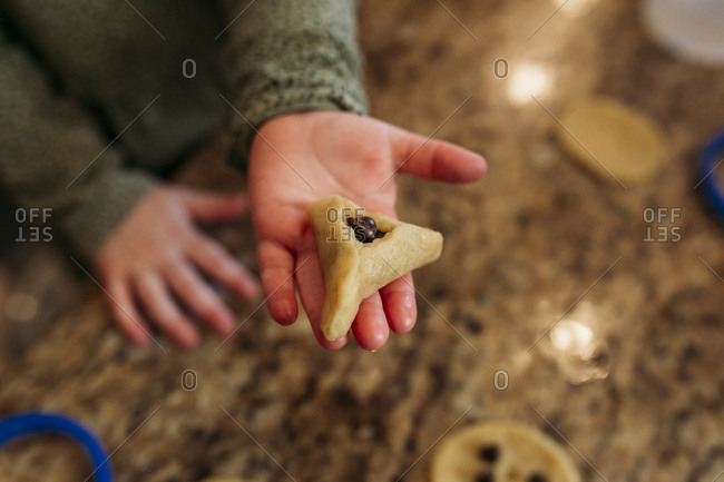 Girl holding a chocolate hamantaschen