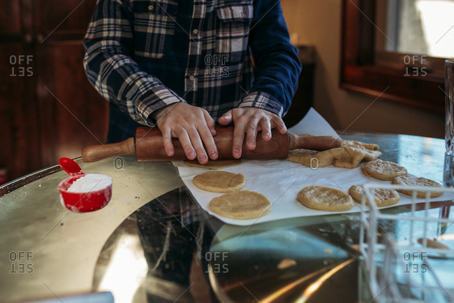 Boy making hamantaschen