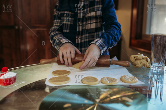 Boy rolling out dough for hamantaschen
