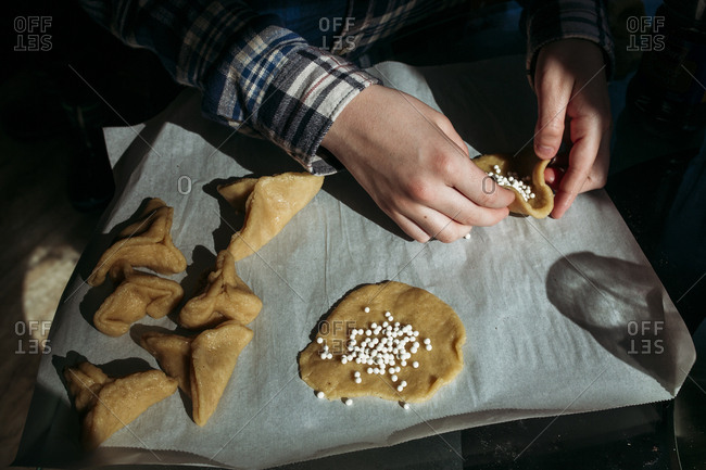 Boy making hamantaschen cookies