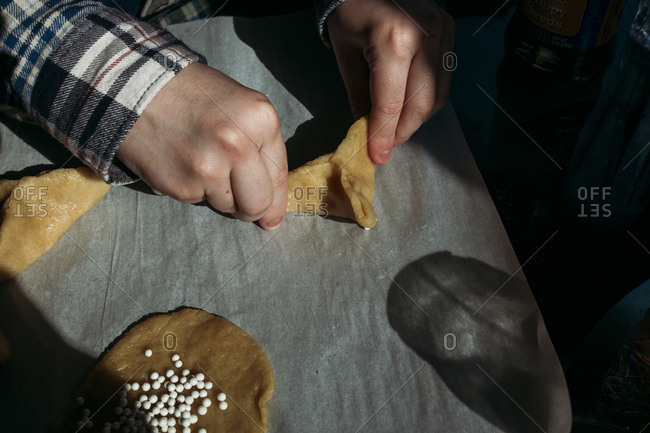 Boy preparing hamantaschen cookies