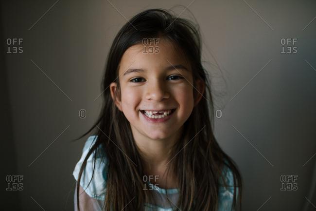 Happy little girl with dark brown hair
