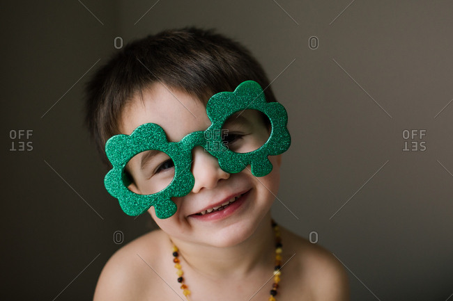 Boy wearing sparkly clover glasses