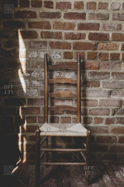 A solo chair along a brick wall at Fort Clinch in Fernandina Beach, Florida