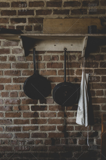 Some pots, pans, and an apron on a shelf in the kitchen at historic Fort Clinch in Fernandina Beach, Florida