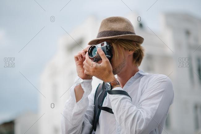 Male tourist takes a photograph