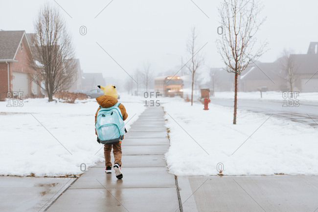 Boy waiting for bus on a winter day