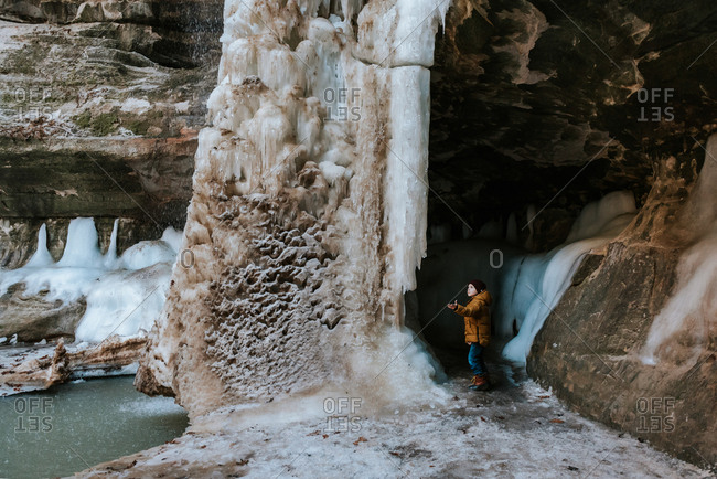 Boy looking at frozen waterfall in Starved Rock State Park