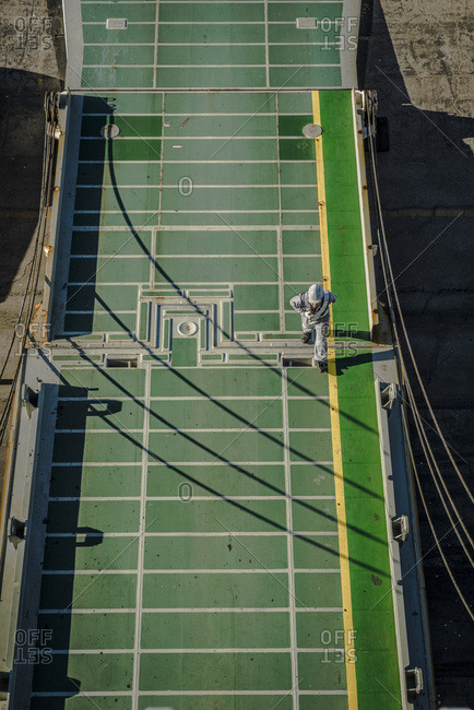Los Angeles, CA - December 13, 2017: A seaman walks along a cargo ramp of a ship docked at the port