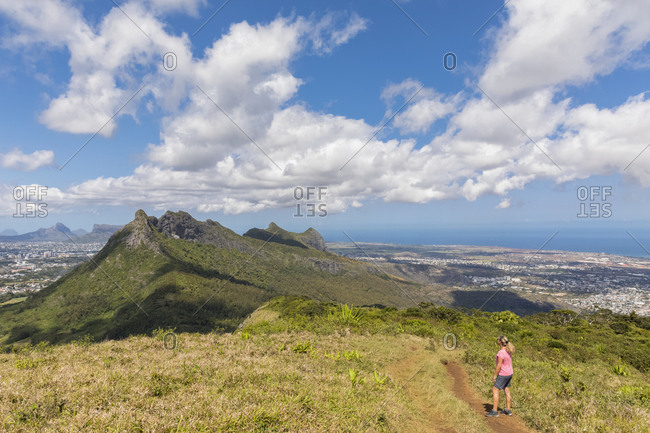 Mauritius- Le Pouce Mountain- female hiker looking to Snail Rock and Port Louis