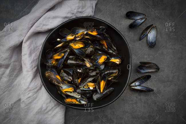 Organic blue mussels in bowl