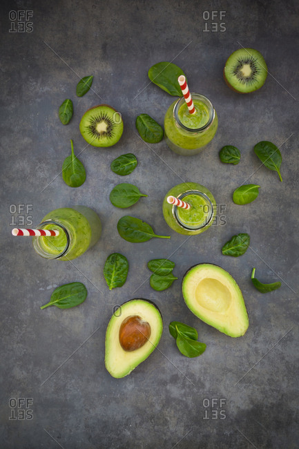Green detox smoothie with avocado- kiwi and baby spinach