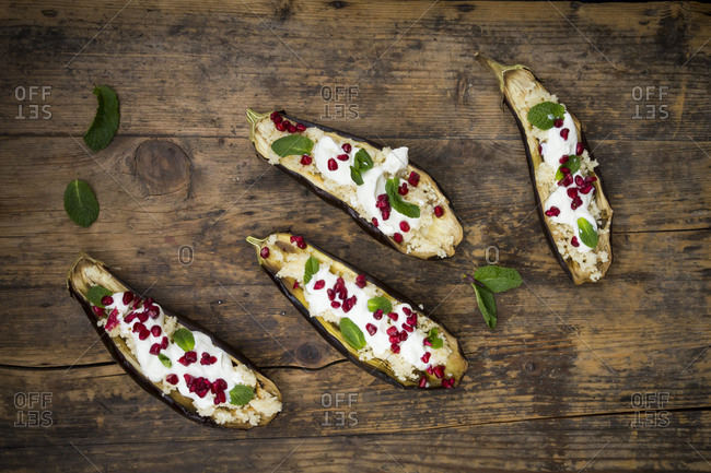 Filled aubergine- couscous- yogurt sauce- mint and pomegranate seeds
