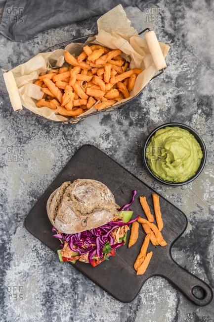 Pulled pork jackfruit burger- sweet potato fries and guacamole