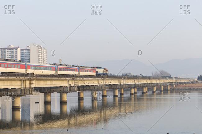 Train on bridge over river