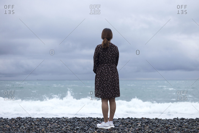 Rear view of a woman looking at the sea