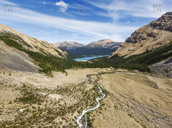 Aerial view of rocky mountains and lake in Alberta, Canada.