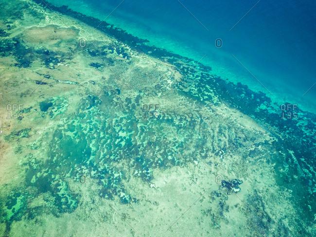 Aerial view of the paradisiac blue sea on Mafia Island, Tanzania.