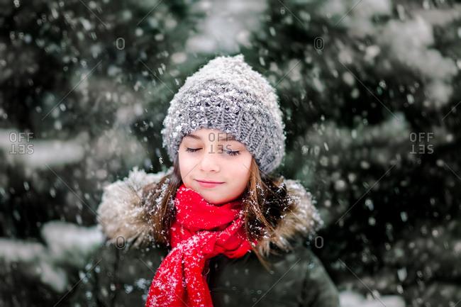 Portrait of girl in falling snow