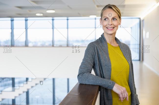 Confident mature businesswoman in office atrium