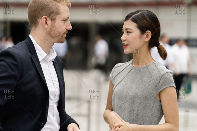 Young city businessman and woman meeting outdoors
