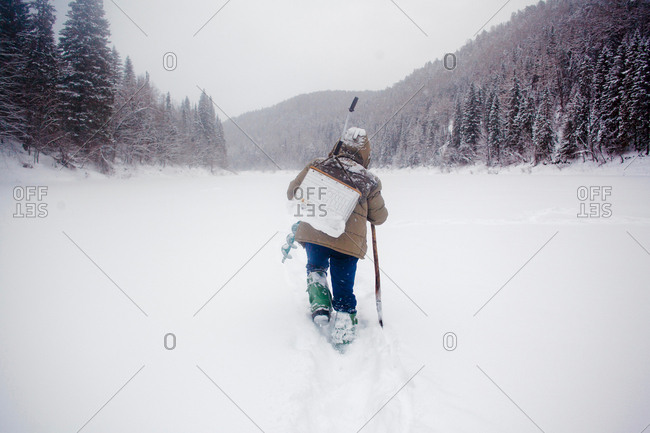 Man walking in heavy snow landscape, Ural, Sverdlovsk, Russia