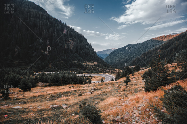 Distant highway with hairpin bend in mountain landscape, Draja, Vaslui, Romania