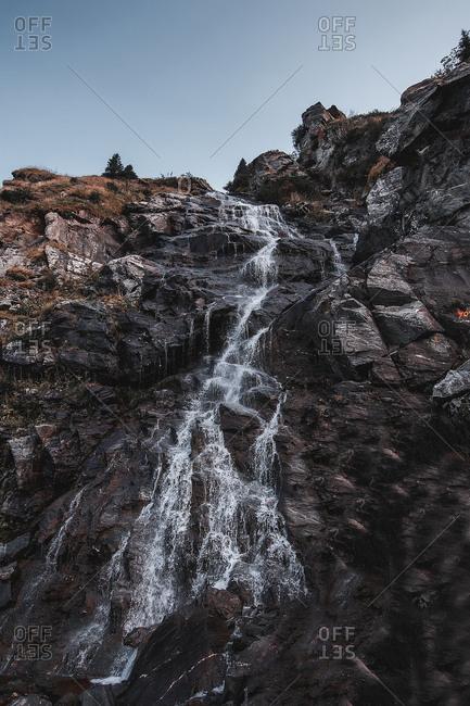Waterfall moving down over rockface, Draja, Vaslui, Romania