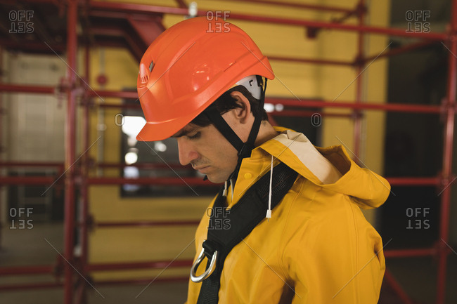 Young male worker wearing hard hat at solar station