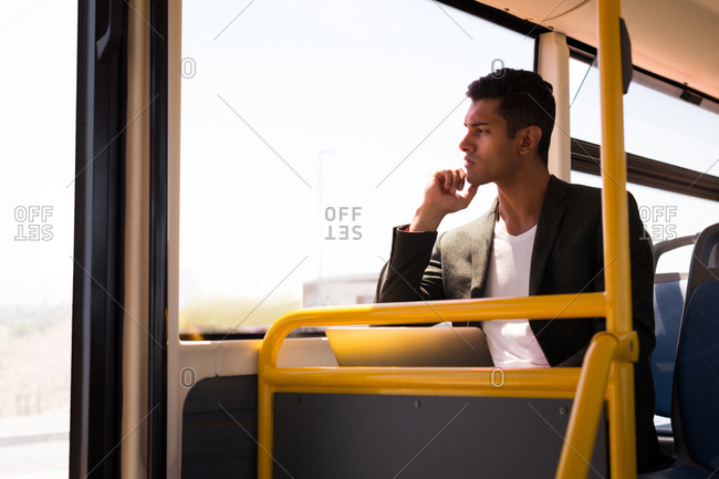 Thoughtful businessman travelling in bus