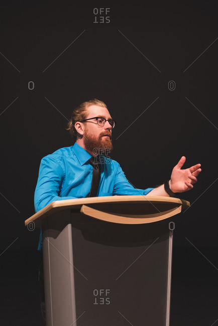 Man practicing his speech on stage at theater
