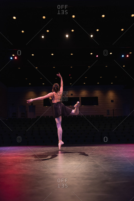 Ballet dancer dancing on stage at theatre