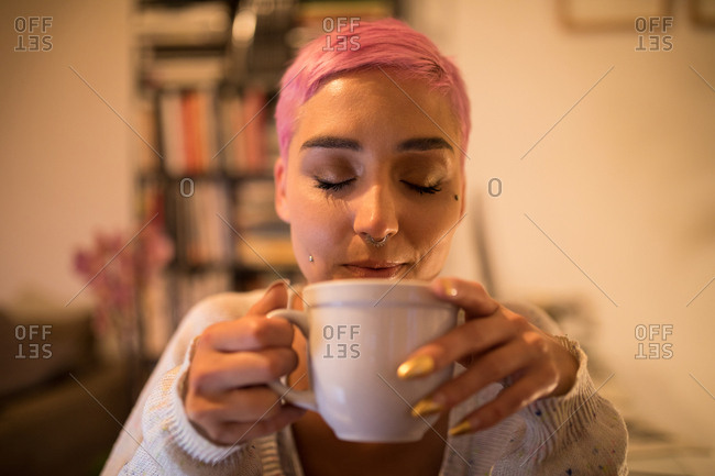 Stylish woman having coffee at home