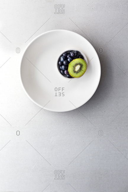 Plate with kiwi and blueberries