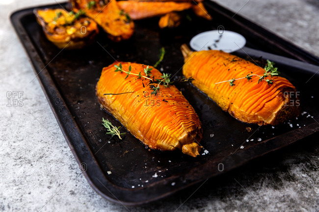 Hasselback butternut squash on roasting tray
