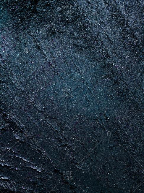 Close-up of dark blue eye shadow powder