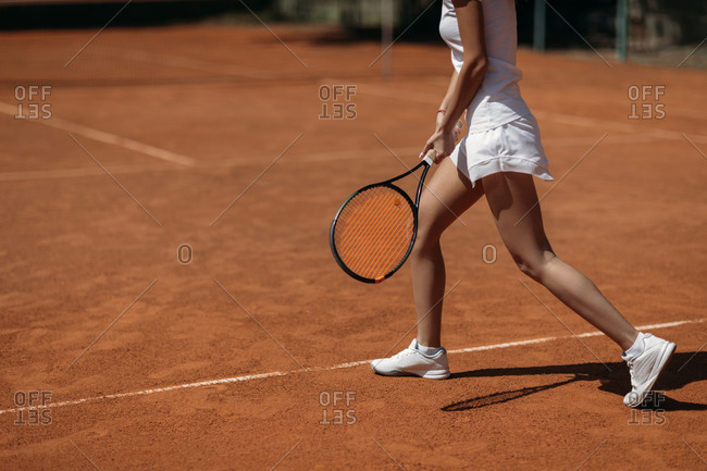 Cropped shot of young sportive woman playing tennis