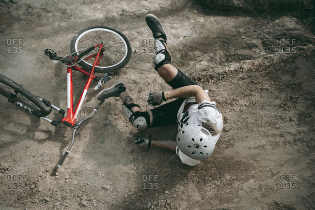 Bike racer falling from bike in helmet